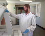 Lab Technician locating samples in open top freezer